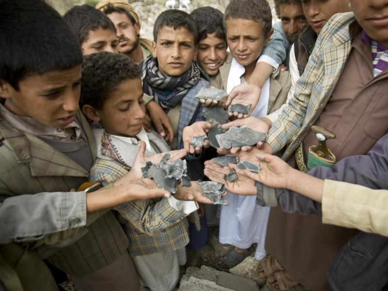 Yemeni boys display shrapnel they collected from the rubble of houses destroyed by Saudi-led airstrikes in a village near Sanaa, Yemen, on Saturday.
