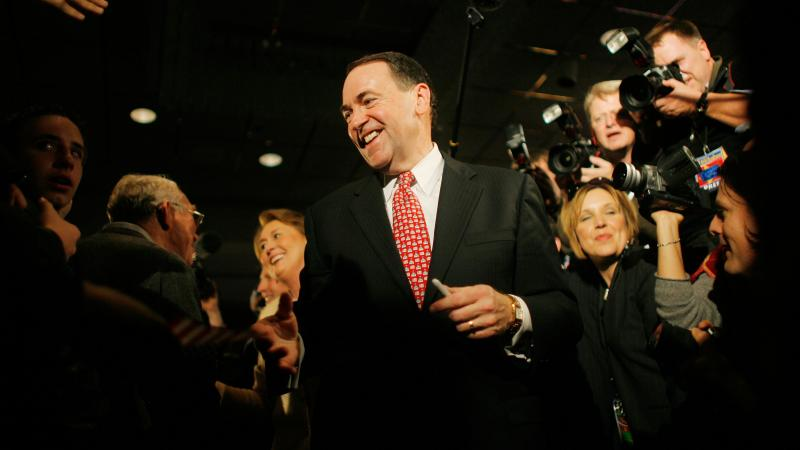Huckabee greets supporters ahead of his victory in the 2008 Iowa caucus.