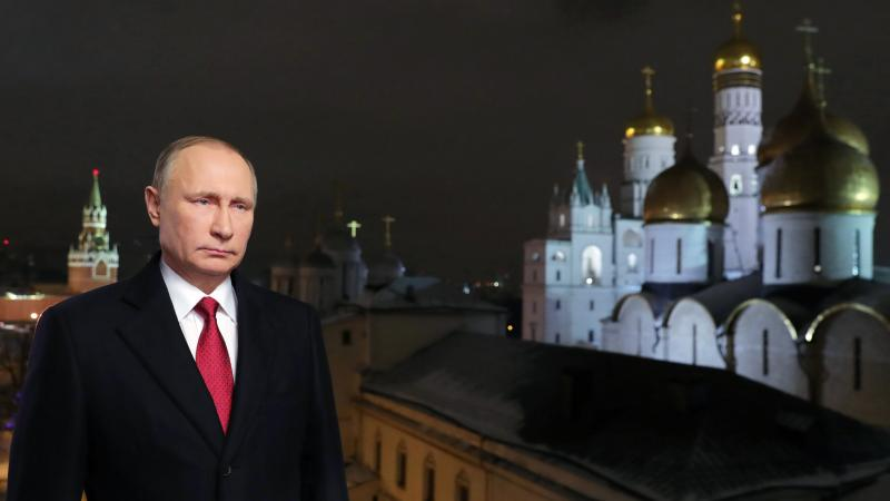 Russian President Vladimir Putin is shown at the Kremlim in Moscow during the recording of his recent New Year's message. Putin's spokesman said Wednesday that the Russian government does not gather compromising material, or kompromat, on political rivals