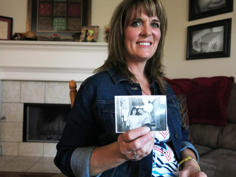 Dana Bowerman's lifelong best friend Michelle Elliott holds a photograph of the two together. Bowerman is serving a nearly 20-year sentence for federal drug conspiracy charges. She was holding out hope for clemency for nonviolent drug offenders but it is