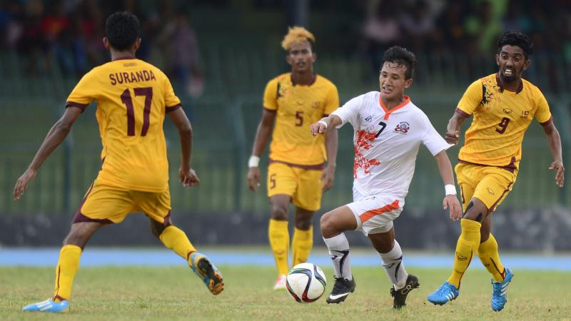 Bhutanese football player Chencho Gyeltshen controls the ball in a March 5 match against Sri Lanka. The striker hit two goals Tuesday to lead Bhutan past Sri Lanka and into the next phase of World Cup Qualifying.