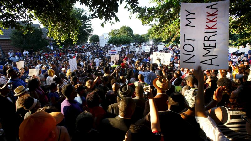 Hundreds of protesters rally in McKinney, Texas, on Monday. Officers' response to a pool party has sparked a debate over racism and the proper use of force.