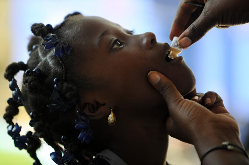 A child receives the second dose of the cholera vaccine in Saut d'Eau, Haiti, last September.
