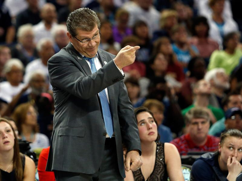 Head coach Geno Auriemma of the Connecticut Huskies calls to his players in the first half against the Notre Dame Fighting Irish.
