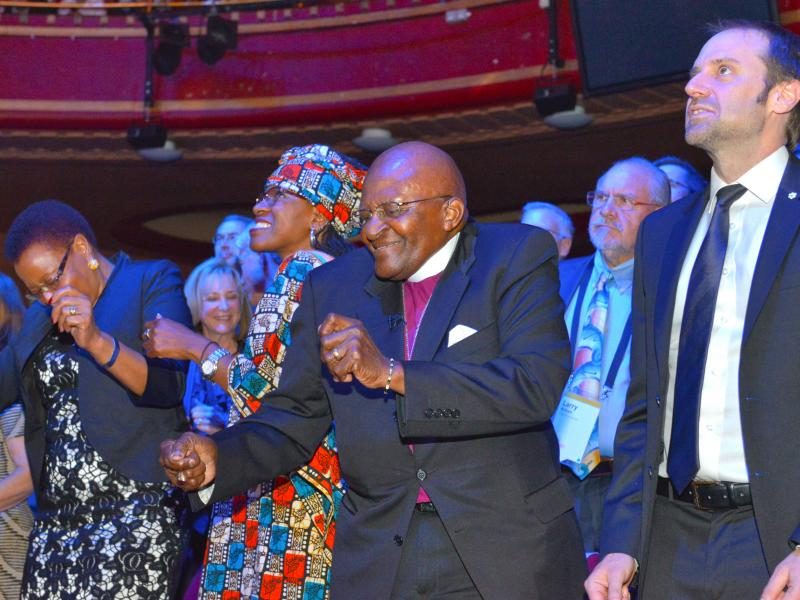 Archbishop Desmond Tutu and his daughter Mpho bust some moves at the 2015 Skoll World Forum.