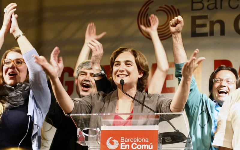 Ada Colau (center), leader of the Barcelona en Comú party, celebrates in Barcelona during a press conference following the results in Spain's municipal and regional elections on May 24. She is the first member of Spain's indignados protest movement to wi