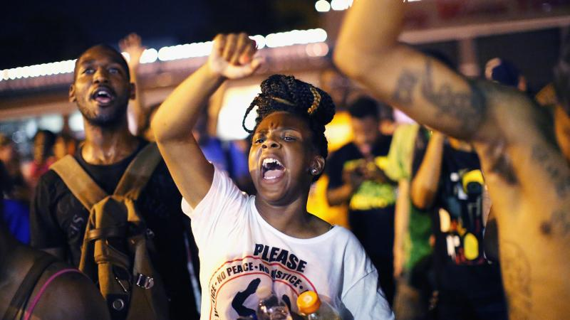 Demonstrators protest the death of Michael Brown on Friday in Ferguson, Mo. Brown was shot and killed by a Ferguson police officer on August 9.