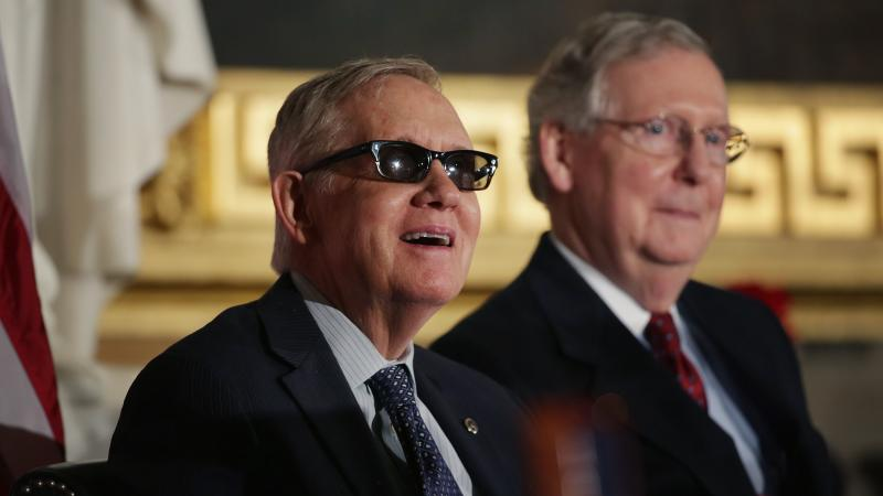 Senate Minority Leader Harry Reid, D-Nev., (left) and Majority Leader Mitch McConnell, R-Ky., at a ceremony last month at the U.S. Capitol.
