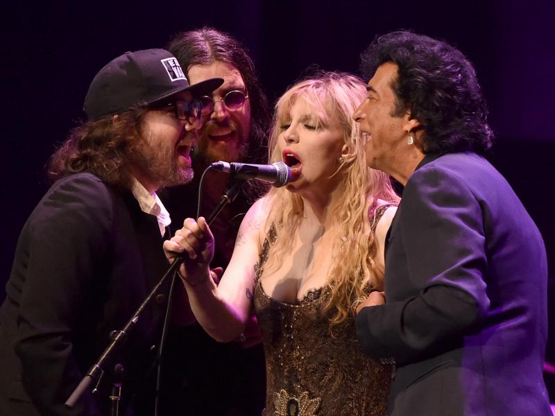 "Musicians Kevin Drew, Damon Fox, Courtney Love and Andy Kim perform onstage during the 60th anniversary celebration of Allen Ginsberg's ""Howl"" Tuesday at the Ace Hotel in Los Angeles."