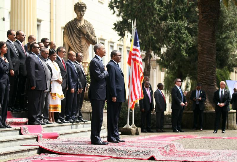 President Obama and his delegation stand Monday during a welcome ceremony with Ethiopia's Prime Minister Hailemariam Desalegn at the National Palace in Addis Ababa, Ethiopia.