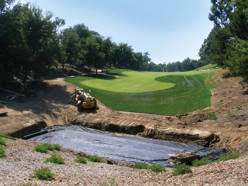 A bio-filtration basin, pictured during installation in 2007, captures water runoff from the Pelican Hill golf club's maintenance facility. The water is filtered through grass, gravel, sand, soil and filter fabric into an underground drainage system.