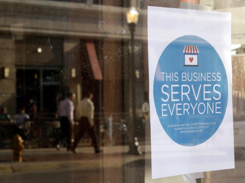 "A sign reading, ""This business serves everyone,"" was placed in the window of Bernadette's Barbershop in downtown Lafayette, Ind., in response to the passage of the state's Religious Freedom Restoration Act."