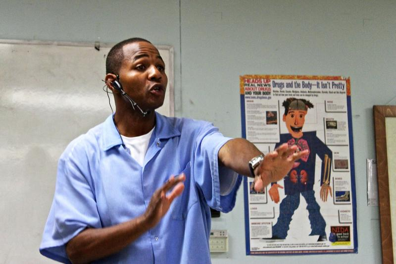 "Curtis Carroll — also known as ""Wall Street"" —  teaches prisoners at San Quentin State Prison about stocks."