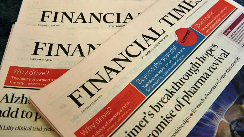 Copies of the Financial Times newspaper are displayed for a photograph in London. British publisher Pearson is selling the paper to Japanese media company Nikkei.
