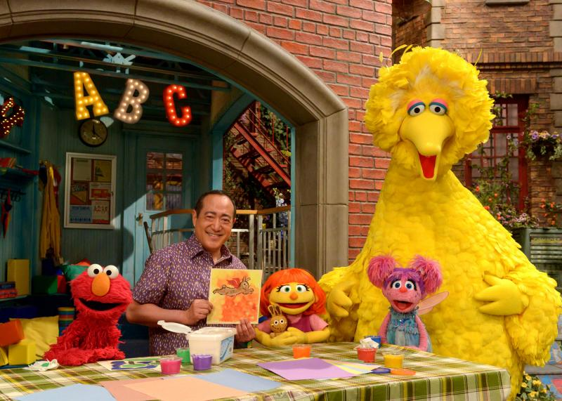 Julia (center) first appeared online and in printed materials as a part of Sesame Street's See Amazing in all Children initiative. She'll now appear on TV as well. From left, Elmo, Alan Muraoka, Julia, Abby Cadabby and Big Bird.