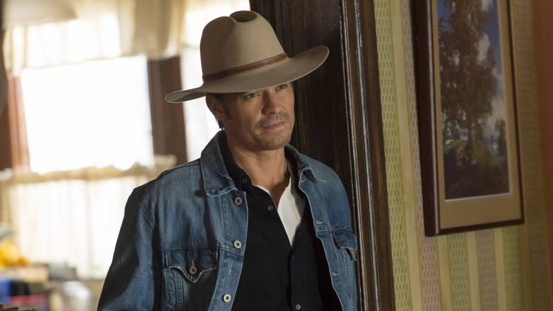 """Timothy Olyphant plays Deputy U.S. Marshal Raylan Givens on FX's Justified, which is based on a novella by Elmore Leonard. The show's creator, Graham Yost, says the only """"tussle"""" the writers had with Leonard happened during the pilot, over which hat Rayla"""