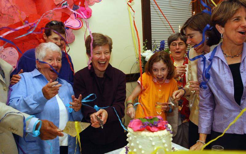 Bonauto celebrates on May 17, 2005, the one-year anniversary of legal same-sex marriage in Massachusetts. Bonauto argued the case that benefited couples like Hillary and Julie Goodridge (at right), here with their daughter Annie.