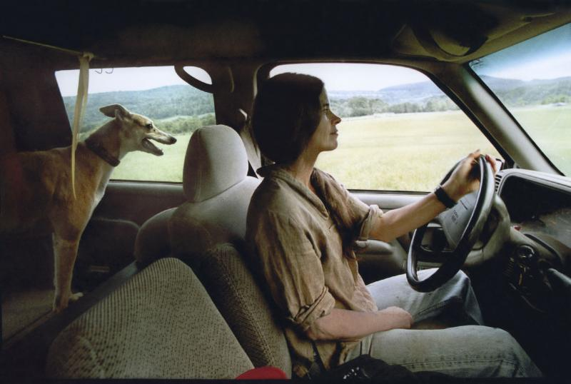 Photographer Sally Mann drives with her greyhound, Honey, in the early 2000s.