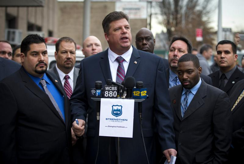 NYPD veteran Brian Fusco speaks to press outside the 72nd Precinct in the Brooklyn borough on Jan. 20. Fusco is running for president of the state's Patrolman's Benevolent Association in the upcoming election, against incumbent Patrick Lynch, who has been