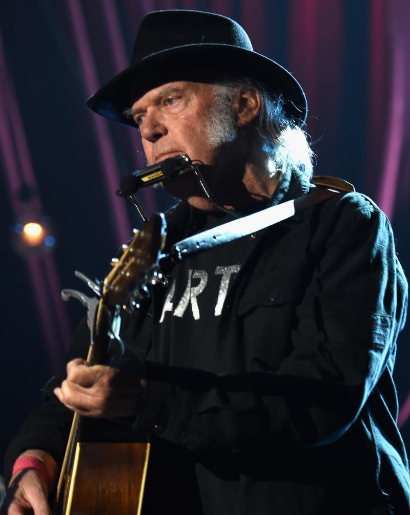"Neil Young says he supports Bernie Sanders — and that Donald Trump shouldn't have used his song ""Rockin' in the Free World."" He's seen here performing in Los Angeles earlier this year."