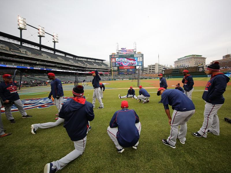 The Minnesota Twins warm up before their Opening Day game against the Detroit Tigers at Comerica Park in Detroit Monday.