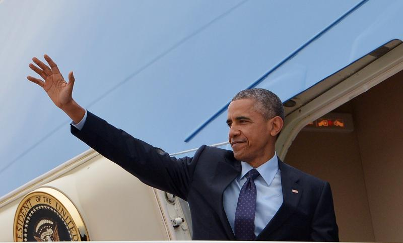 President Obama waves from Air Force One before departing from Andrews Air Force Base in Maryland on Wednesday.