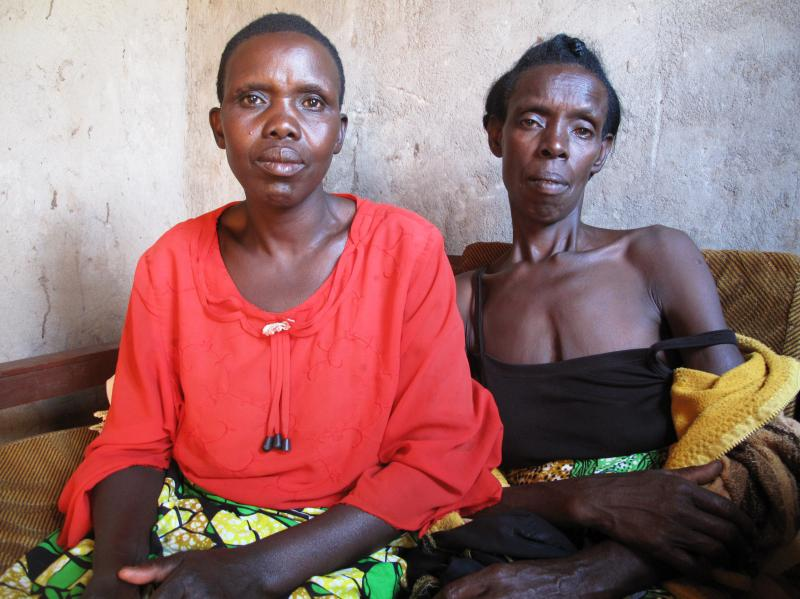 """Godleaves Mukamunana, left, hid Domitil Mukakumuranga, in her house for weeks so that Hutu militias wouldn't kill her. """"Seeing her alive is the best thing,"""" Mukamunana says. """"That kind of relationship we have is priceless. The fact that I don't have more"""