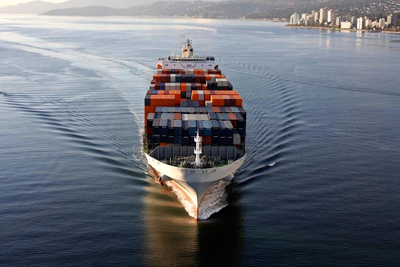 A fully loaded container ship sails along the coast. Historically, ships have taken most of the sea measurements that go into the estimate of Earth's average surface temperature.