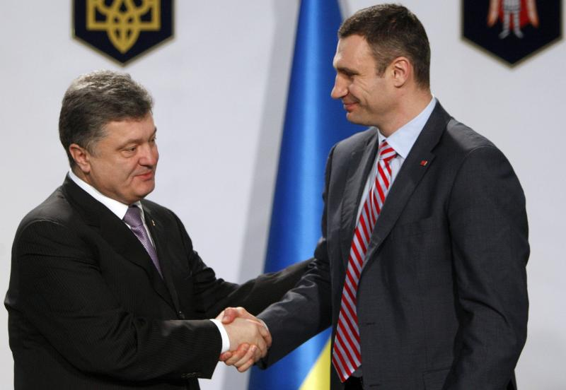 Boxer-turned-opposition leader Vitali Klitschko, right, dropped out of Ukraine's presidential election set for May 25. He says he will help business tycoon and politician Petro Poroshenko, left, who made a fortune selling chocolates. He favors closer ties