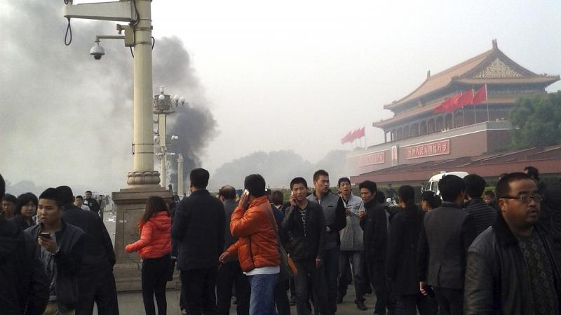 Smoke rises from Tiananmen Square in Beijing on Oct. 28, when three Uighurs, a mostly Muslim ethnic minority, drove a jeep into a crowd there, killing two tourists. The people inside the car died as well, after they set their vehicle on fire.