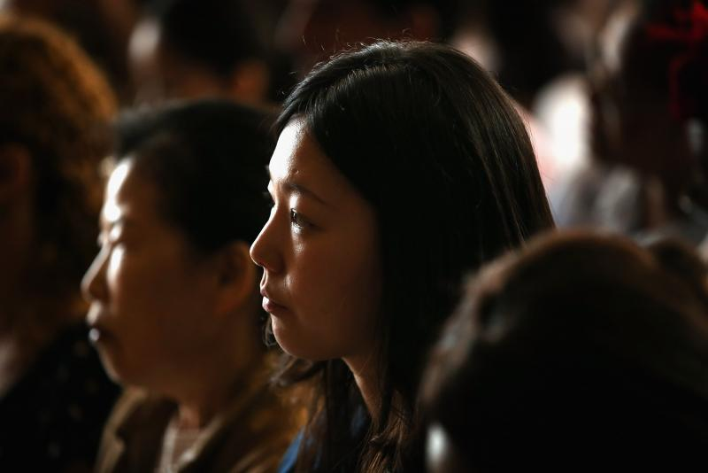 Jihye Jang of Korea participates in a naturalization ceremony at the Chicago Cultural Center on July 3, 2013, in Chicago.