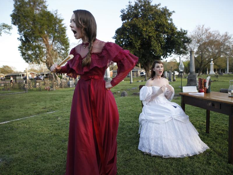 Kameron Shook, 17, and Brenna Paola, 17, perform as part of Tales From the Crypt in Friendship Cemetery in Columbus, Miss.