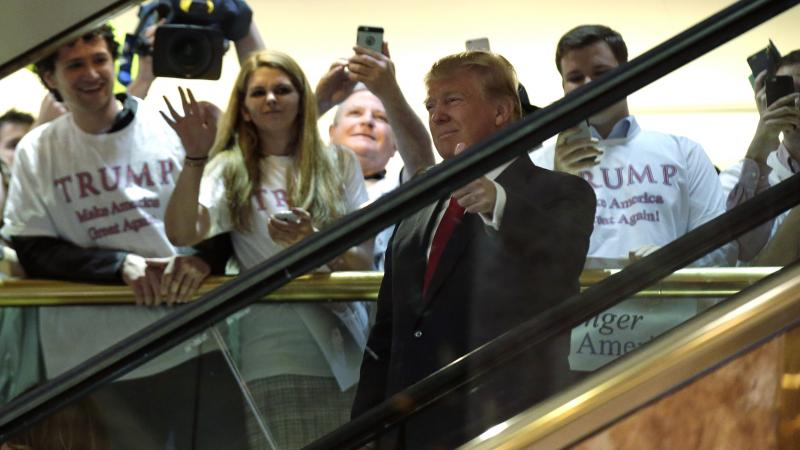 "Republican presidential candidate and TV personality Donald Trump arrives by escalator to the tune of ""Rockin' in the Free World."" Musician Neil Young did not approve of his song choice."