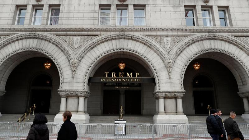 The recently opened Trump International Hotel on Pennsylvania Avenue in Washington, D.C., is one of many properties that would lose the Trump name if the president-elect followed the advice of the Office of Government Ethics and divested his business hold