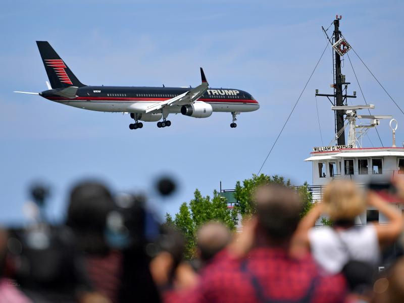 Donald Trump's plane arrives at a welcome event with Gov. Mike Pence at the Great Lakes Science Centre on Wednesday in Cleveland