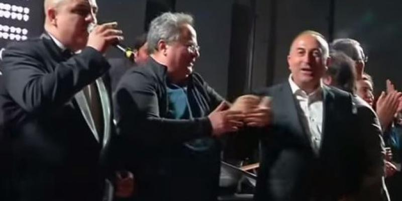 """NATO foreign ministers in Antalya, Turkey, were persuaded at the end of their meeting this week to come up on stage for a rendition of """"We are the World."""""""