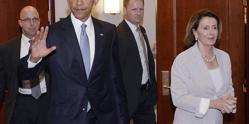 President Obama walks alongside House Minority Leader Nancy Pelosi, who was among the Democrats who sank his trade agenda last week.