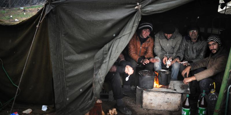 Refugees warm their hands at a refugee camp in Harmanli, Bulgaria, on Nov. 27. More Syrians are turning up in Europe. Many are trying to get to northern Europe, believing that is the best place to start a new life.