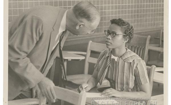 R. J. Reynolds High School principal, Claude Joyner and Gwendolyn Bailey, at her enrollment at the school, 1957.