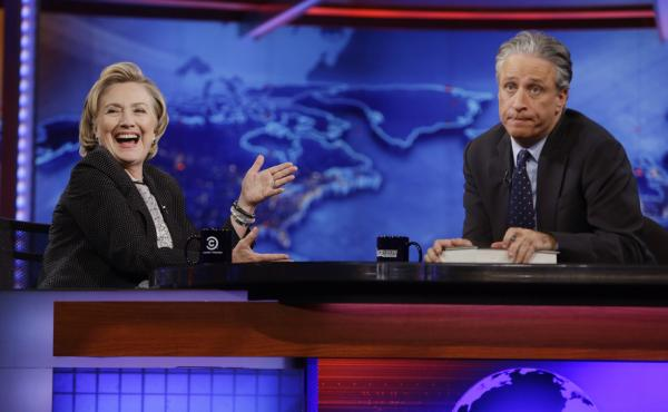 Hillary Clinton reacts to host Jon Stewart on The Daily Show in 2014. According to a new survey, Bernie Sanders' supporters are more likely to watch the show than are Clinton's supporters.