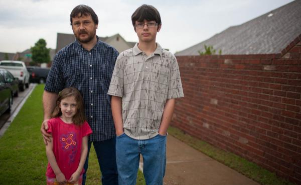 Cary Smith had picked up his son Jordan, 13, and daughter Tia, 5, from school on Monday, right before the tornado came through Moore. He and the family live close to Plaza Elementary, and he ran to the school to help pull a teacher and three kids from the