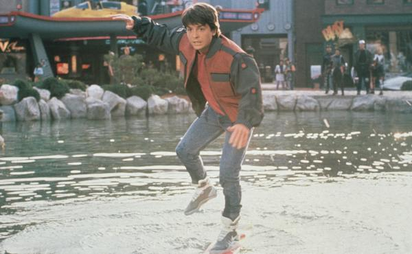 In Back to the Future Part II, Marty McFly (Michael J. Fox) slips on his Nike sneakers and rides a Mattel hoverboard in front of a Texaco gas station.