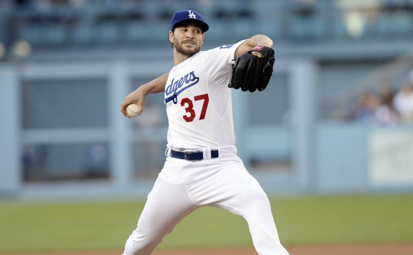 Los Angeles Dodgers pitcher Brandon Beachy throws against the Milwaukee Brewers on July 11 at Dodger Stadium. It marked his comeback from a second Tommy John surgery to his right elbow.