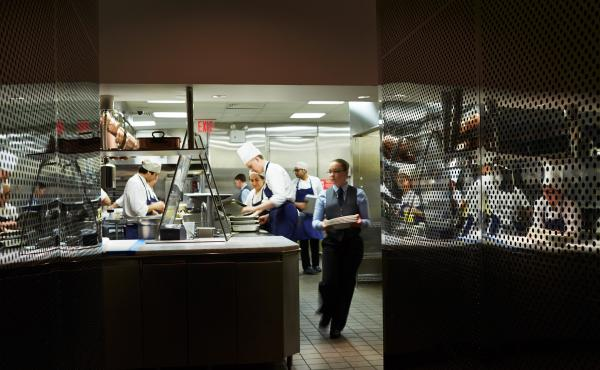 Staff in the kitchen of The Modern, a restaurant operated by Meyer's Union Square Hospitality Group and located in the Museum of Modern Art.