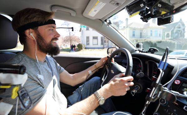 Monitored by researchers and cameras, a study participant drives while using hands-free technology. New AAA research found that these technologies are distracting even after they're used.