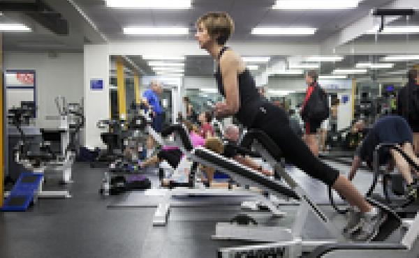 Janet Wertheimer does a back hyperextension exercise at Boston Sports Club in Wellesley, Mass. Regular exercise has helped control her chronic back pain.