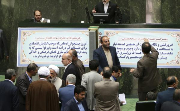 Ali Akbar Salehi, top, the head of Iran's Atomic Energy Organization, delivers a speech as lawmakers and officials discuss a bill on Iran's nuclear deal in parliament on Sunday. The parliament approved an outline of a bill allowing the deal's implementati