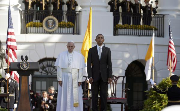 President Barack Obama and Pope Francis stand at attention during the playing of the national anthems during a state arrival ceremony for the pope on the South Lawn of the White House Wednesday.