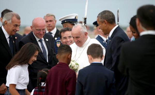 Pope Francis, accompanied by President Barack Obama and others, is greeted upon his arrival at Andrews Air Force Base, Md.