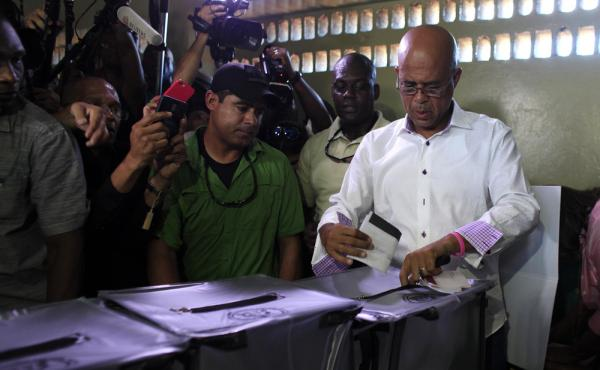 Haiti's President Michel Martelly casts his ballot during elections in the Petion-Ville suburb of Port-au-Prince, Haiti, Sunday. The country is holding the first-round presidential vote Sunday along with balloting for numerous legislative races and local